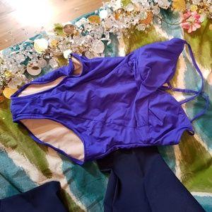 Other - The slim suit purple one piece bathing suit sz 14